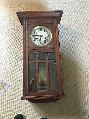 Arts & Crafts Oak Chiming Wall Clock. Nice Carving and Bevelled Glass. Excellent