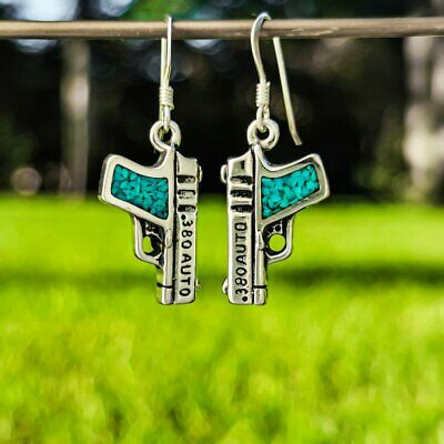 Sterling silver .380 Semi Automatic gun earrings with inlaid Kingman Turquoise