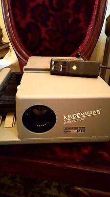 KINDERMANN DIAFOCUS AF 35mm SLIDE PROJECTOR. BOXED + HAND REMOTE + INSTRUCTIONS