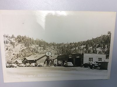 Real Photo Postcard of Frenchy's in Wolf Creek, Montana. Esso Gas and Pennzoil