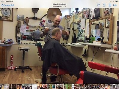 Established barber shop business for sale.