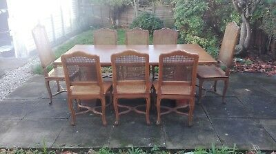 French dining table and rattan chairs