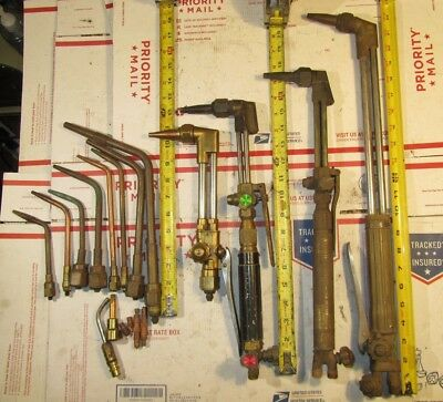 (4) Oxy acetylene torches, (8) welding tips