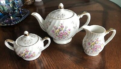 Vintage Tea Pot, Creamer And Sugar Floral Swirl Set made in Japan