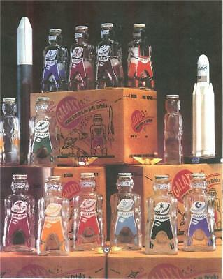 12 GALAXY SYRUP BOTTLES SPACEMEN COIN PIGGY BANKS and SCI-FI BOX 1950's