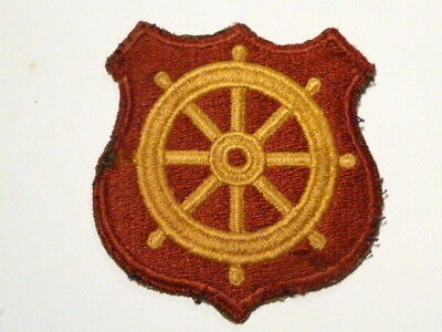 A   WW 2 U S Army Port of Embarkation Cut Edge Snow Back Patch