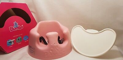 Pink bumbo baby seat with straps and tray