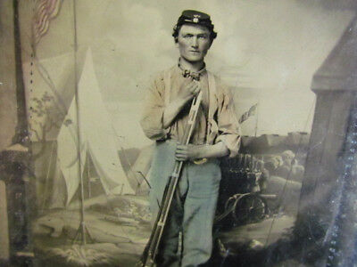 possible Pennsylvania armed soldier -w-coloring in front backdrop tintype photo