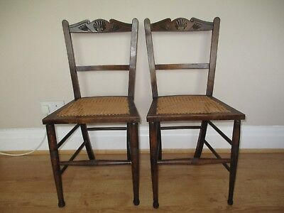 Pair of oak side chairs, Arts & Crafts carving on back bar & woven canned seats