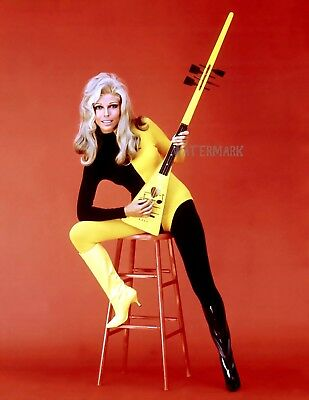 Nancy Sinatra With Guitar Wearing A Groovy Space-Like Outfit Publicity Photo