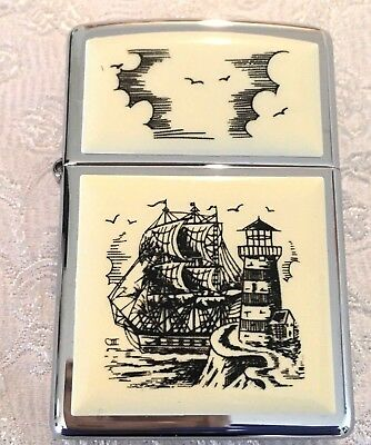 New in Box Vintage 1999 Zippo Lighter Scrimshaw Ship & Lighthouse
