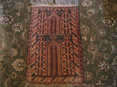 An old hand knotted prayer rug