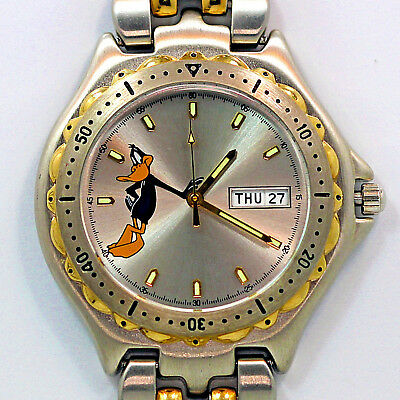 Daffy Duck Fossil Blue Style Day Date Mans Quartz 30M WR, Watch 2 Tone Band $119
