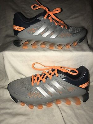 watch 7dcff 3d3fe Men s 5.5 Women s 6.5 Adidas Springblade Orange Silver Glow Running Shoes.