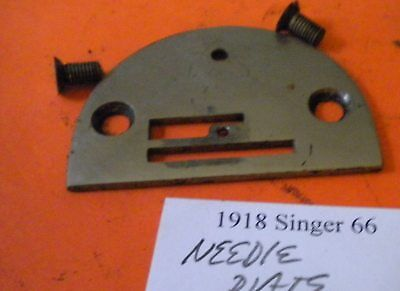 Needle plate and screws 32602 from a 1918 Singer 66 sewing machine