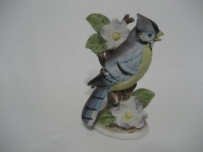 Blue Jay Sitting in Branch of Dogwood Tree Bisque Figurine