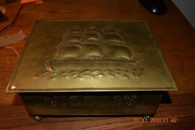 Arts and crafts brass box with claw feet - embossed with Nelson's Victory