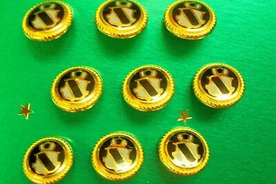 9 Italian gilded and enamelled black and white crested fashion buttons 16 mm.
