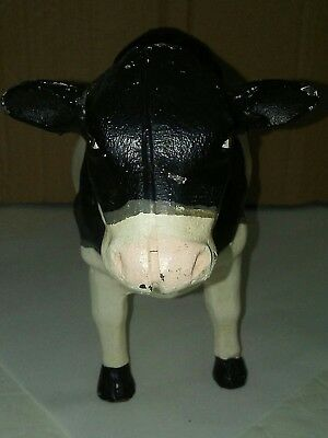 "Vintage Cast Iron Holstein Dairy Cow  Door Stop 11"" long 6 1/2"" tall 4"" wide"