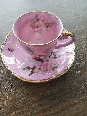 Unmarked Pink And Gold Cup And Saucer Set