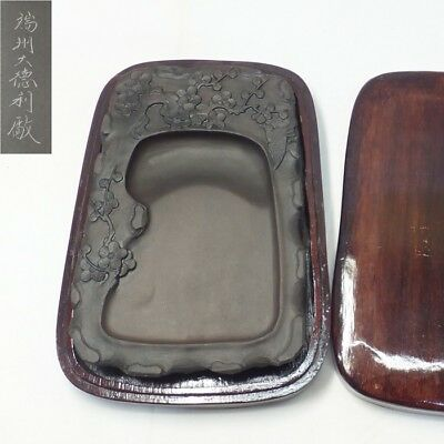 B563: Chinese calligraphy tool. An ink stone with very good sculpture of plum