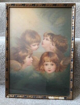 Old vintage framed picture/print faces angels cherubs in an old picture frame.