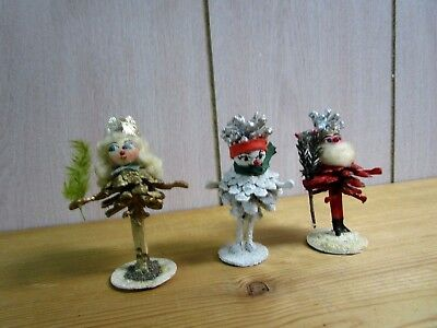 Vintage German holiday stick leg, pine cone, spun cotton heads elves, lot of 3