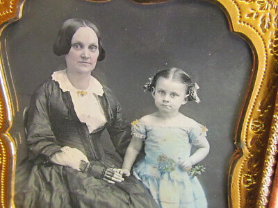 young mother & daughter holding flowers with coloring daguerreotype by Bogardus