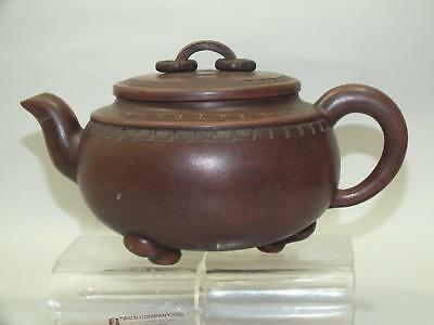 (c) A CHINESE YIXING RED POTTERY CIRCULAR INCISED SIGNED TEA-POT  20thC