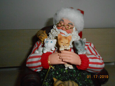 Clothtique santa possible dreams sitting with kittens