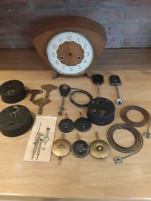 Vintage clock parts smiths and other assorted parts included key winders