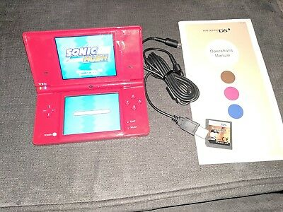 Nintendo dsi console, USB charger, 2 games