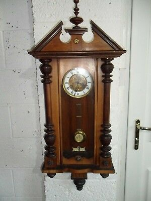 Antique Pendulum wall cabinet clock, with key