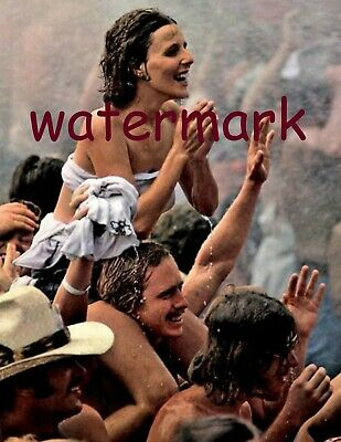 Girl sitting on shoulders in the Rain at the First Woodstock1969 Publicity Photo