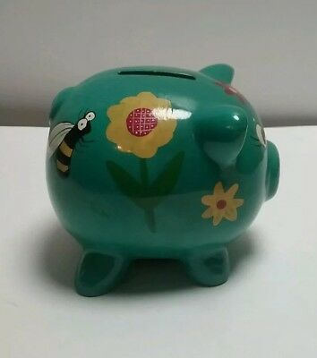 Green Piggy Bank Decorated with flowers and bees