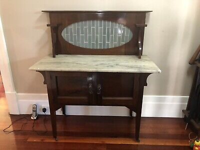 Marble topped antique washstand with grey tiles