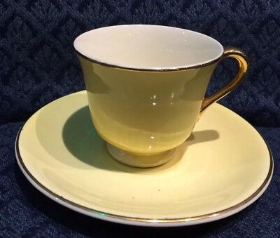 Vintage Steubenville Yellow Demitasse Cup and Saucer Gold Trim