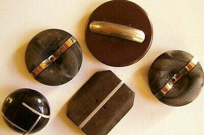 A mixed lot of 5  'feature' buttons with a metal element.
