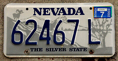 Nevada Ram on Mountain Top with Joshua Tree License Plate with a 2002 Sticker
