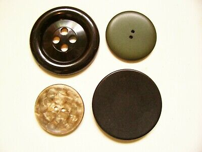 A mixed lot of 4 vintage large 'feature' buttons. (2 Largest 6 cms. diameter)