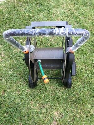Garden Hose Reel portable with wheels Never Used still has wrapping