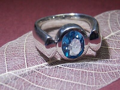 Art Deco sterling silver ring set with stunning Blue Topaz