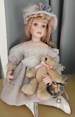 Copperart Porcelain Sitting Doll With Own Small Teddy