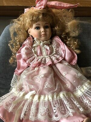 Antique French porcelain head doll in beautiful pink satin, lace & pearl dress