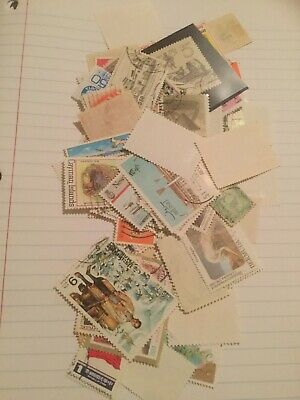 Lot of 100 different worldwide stamps Varying From Used To MNH With Gum