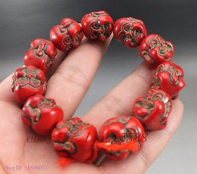 Collection of old Chinese red coral happy Buddha bracelet