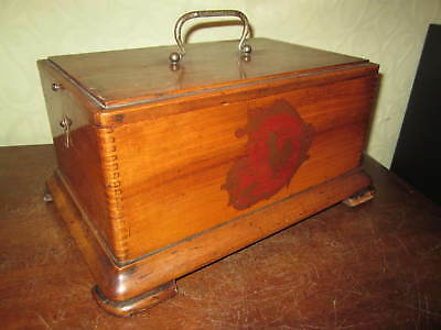 An attractive old jointed wooden box