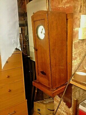 large cased Fusee Clock on wooden oak bracket mount