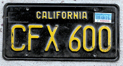 1963 Yellow on Black California License Plate with a 1976 Sticker