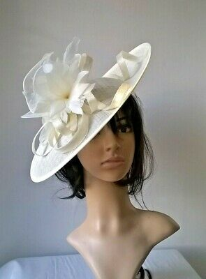 Ivory Feather Fascinator..Hatinator shaped disc Wedding.races.new